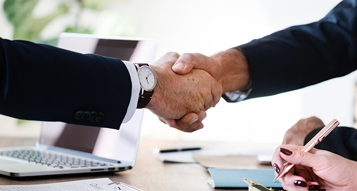 Handshake after making deal with a barter and trade website